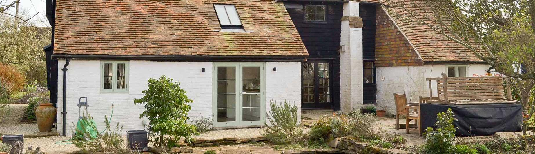 Tenterden Roofing - White Brick House