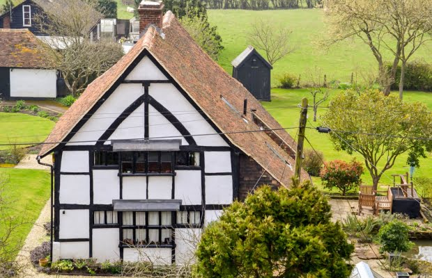 Tenterden Roofing - White Tudor House And Fields