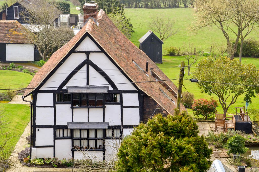 Tenterden Roofing - White Tudor House And Fields